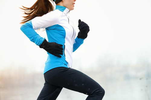 Woman running outside during winter weather