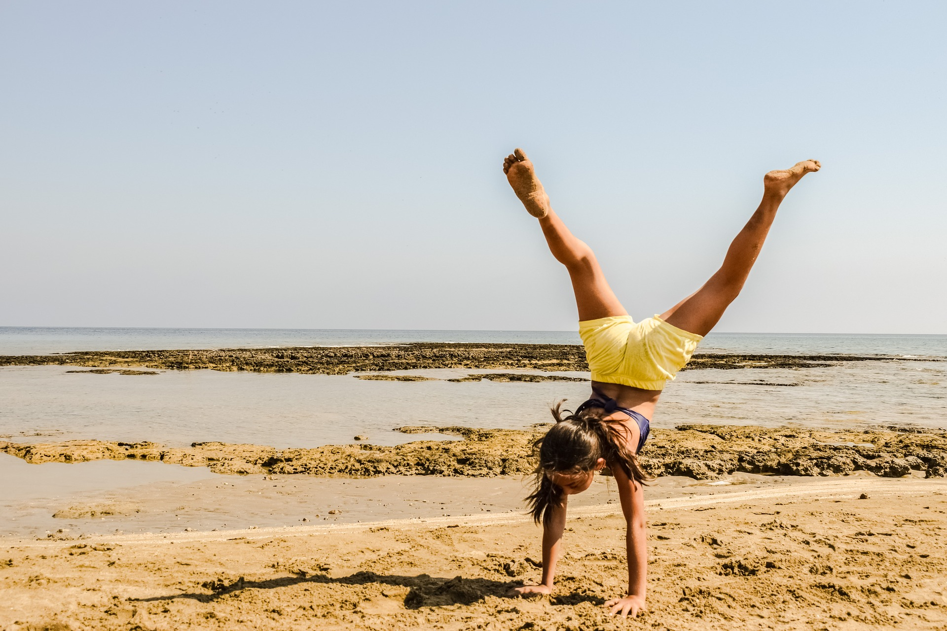 Woman doing handstands and who may not have varicose veins