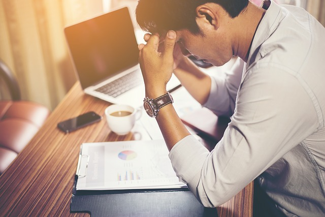 Man is stressed out at desk