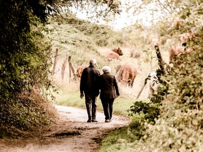 Seniors who are seeking walking along a tree lined trail