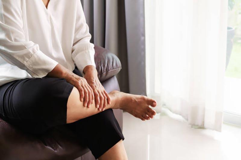 senior woman suffering from varicose veins