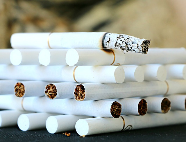 Cigarettes stacked in rows on top of each other