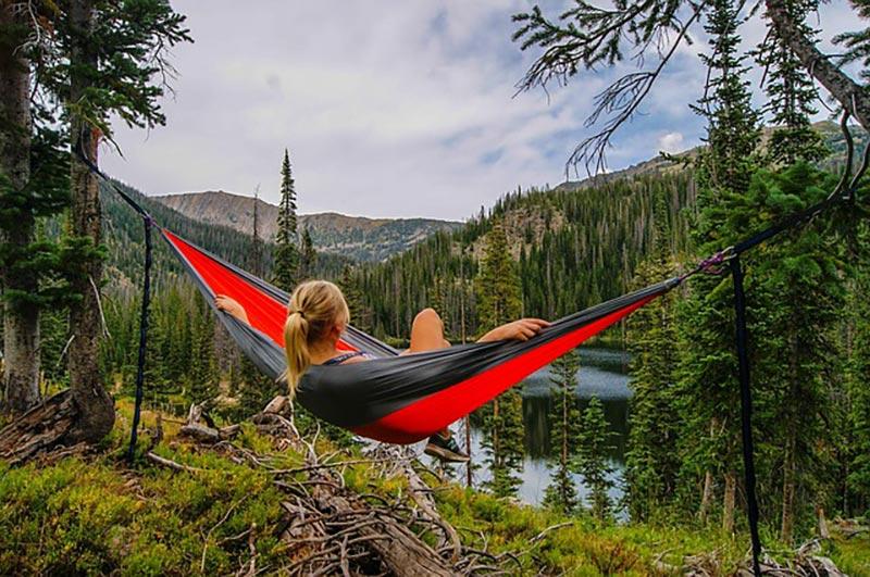 woman laying in a hammock