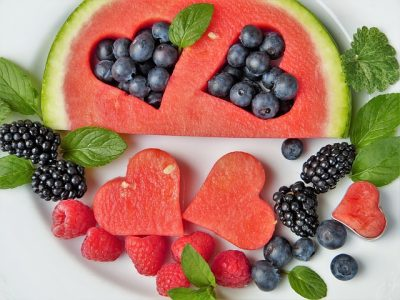 Cut and arranged watermelon, blueberries, raspberries, and black berries