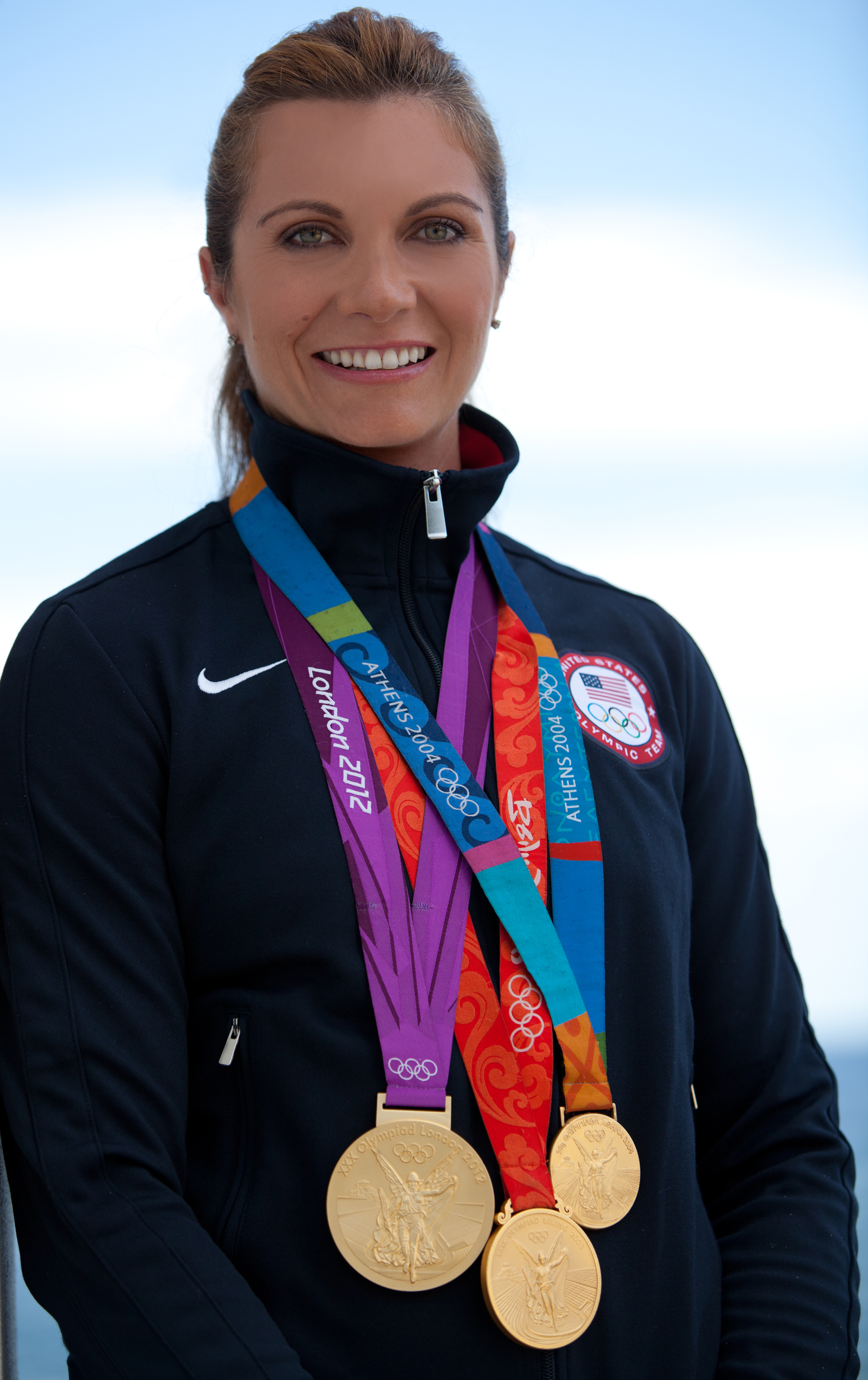 VCA Spokeswoman Misty May-Treanor with Olympic medals