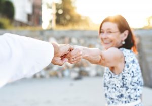 Healthy Looking Old Woman holding husbands hand