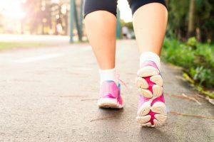 woman walking in tennis shoes