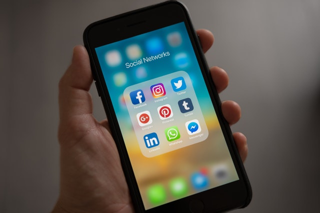 daunting picture of a phone with social media icons