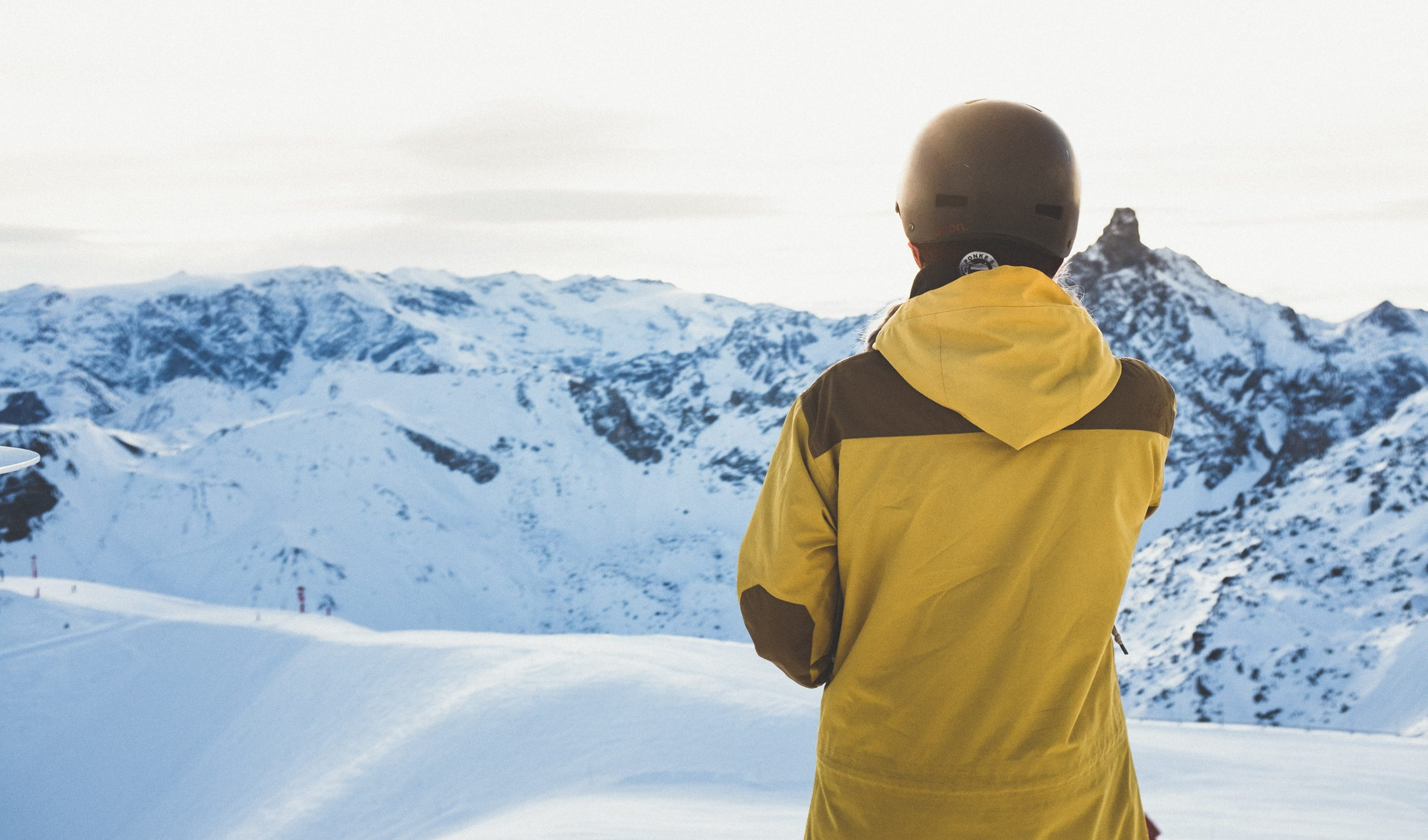 man standing on a snowy mountain during the winter