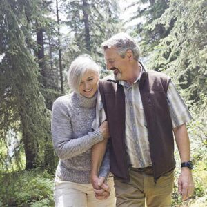 Affectionate couple walking through forest