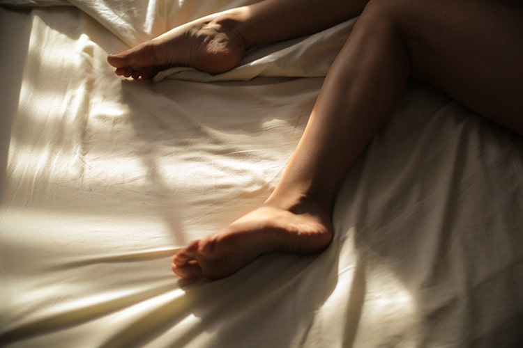 women laying in bed