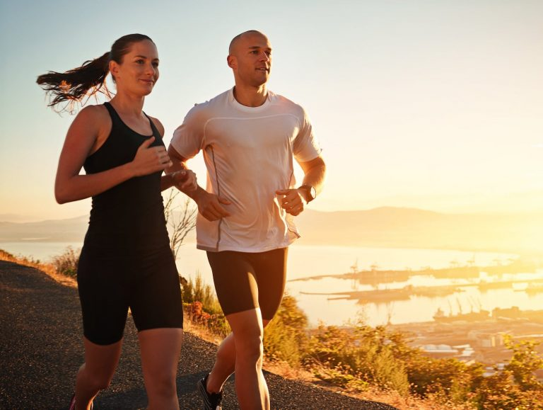 fit couple running outside