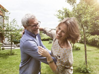 Couple dancing outside in the grass