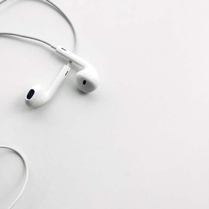 pair of white Apple headphones