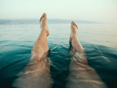 mans legs floating in water