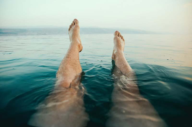 man legs floating in water