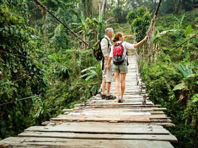 couple walking on an outdoor bridge