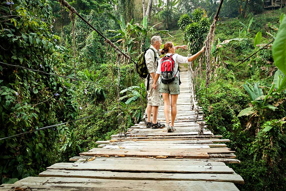 couple walking on an outdoor bridge