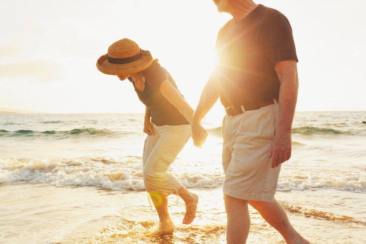happy couple walking on the shoreline