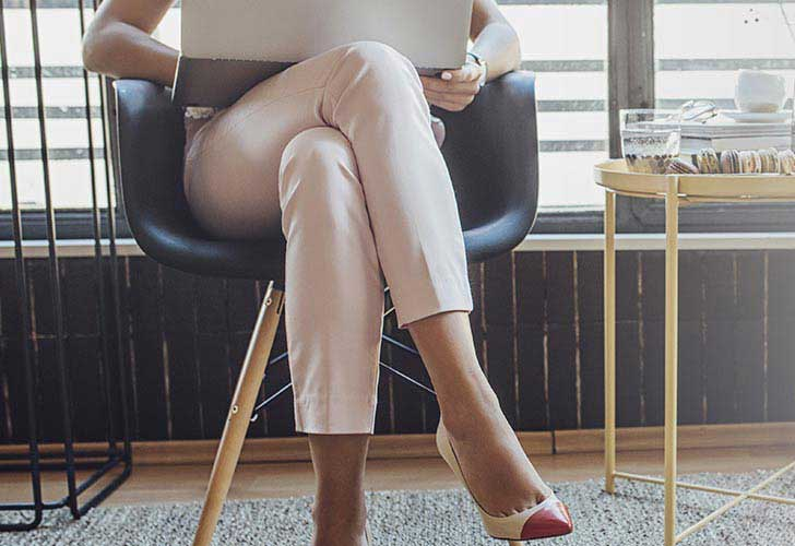 woman in waiting room with legs crossed