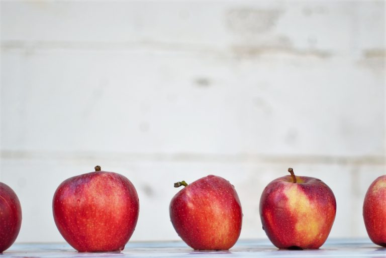 row of red apples lined up