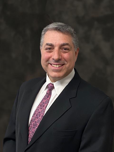Dr. Adam Corrado headshot