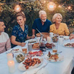 family eating dinner together outside