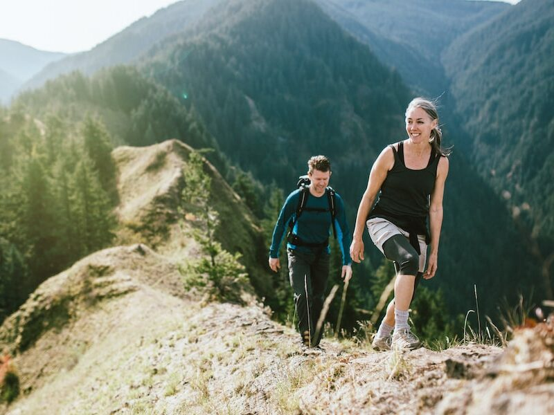 fit couple hiking on mountain